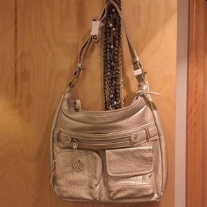NWT, Kim Rogers Champagne grain leather bag.